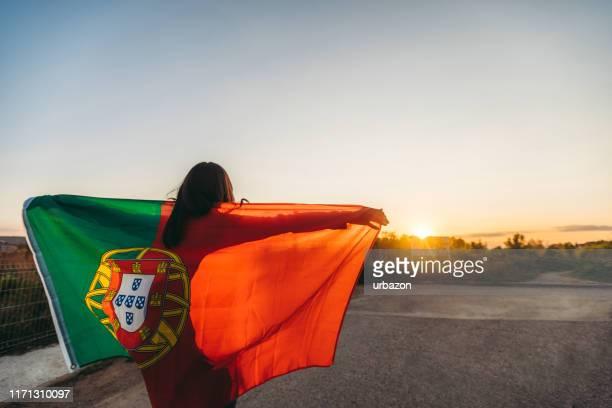 portuguese flag at sunset - bandeira de portugal imagens e fotografias de stock