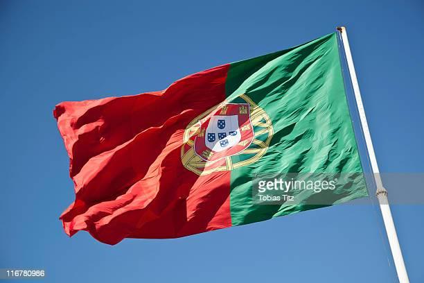 portuguese flag flying - bandeira de portugal imagens e fotografias de stock