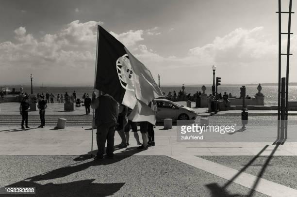 portuguese flag in lisbon - bandeira de portugal imagens e fotografias de stock