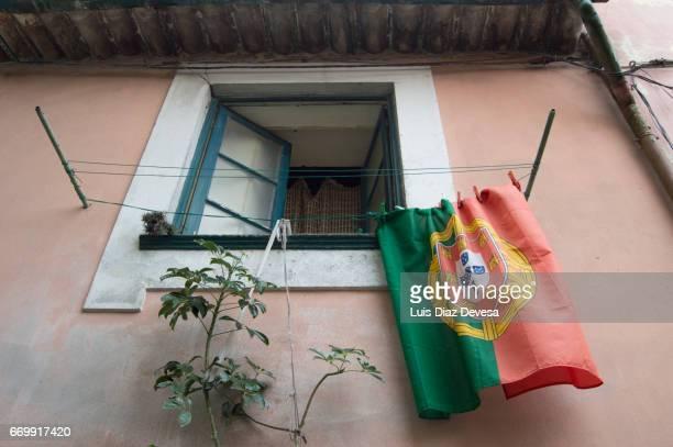 Portuguese flag on clothesline.