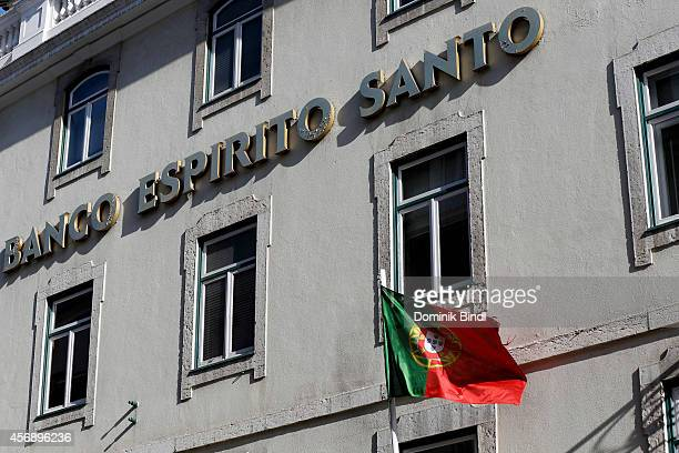 Portuguese Flag waves in front of a building of portuguese Bank Banco espirito santo now called Novo Banco on August 28 2014 in Lisbon Portugal
