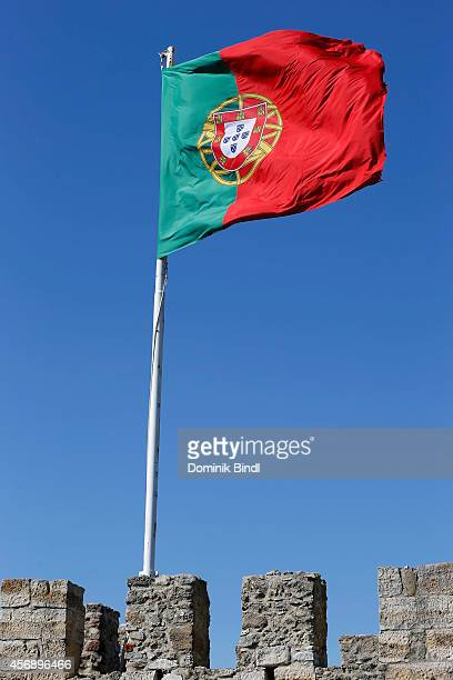 Portuguese Flag waves on top of Sao Jorge Castle on August 28 2014 in Lisbon Portugal