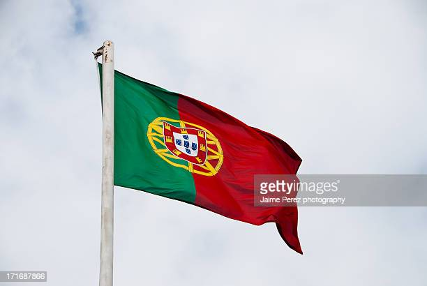 portuguese flag waving in the wind - bandeira de portugal imagens e fotografias de stock