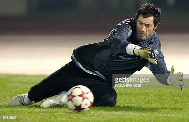 Portuguese football club FC Porto goalkeeper Vitor Baia tries to catch a ball during a practice session for the 25th Toyota European/South American...