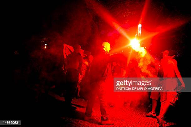 Portuguese football fans celebrate the victory of their team at Campo Pequeno Square in Lisbon on June 21 after the UEFA EURO 2012 football...