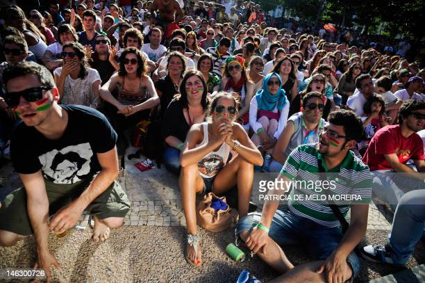 Portuguese football fans watch the Euro 2012 football championship match between Portugal and Denmark at Campo Pequeno Square in Lisbon June 13 2012...