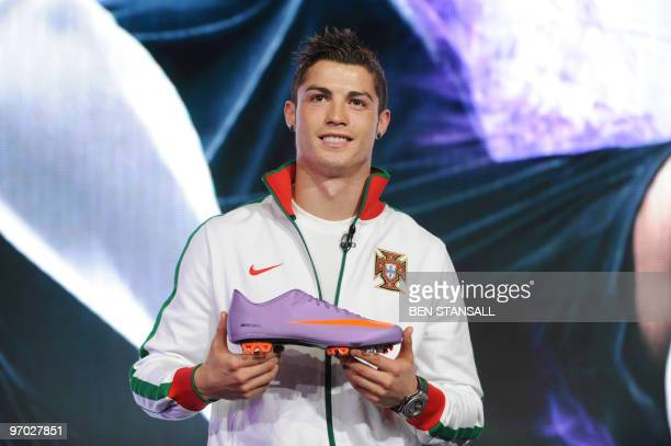 Portuguese football player Cristiano Ronaldo holds a Nike Mercurial Vapor Superfly II football boot during a Nike press conference in London on...