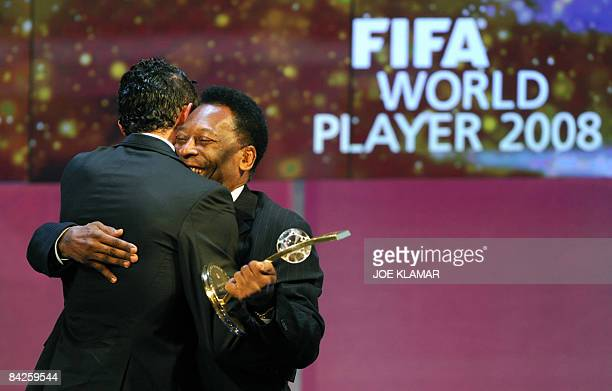 Portuguese football player Cristiano Ronaldo is congratulated by Brazilian football legend Pele after recieving the FIFA world footballer of the year...
