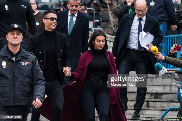 Portuguese football player Cristiano Ronaldo leaves 'Audiencia provincial' court with his girlfriend Georgina Rodriguez after tax evasion trial