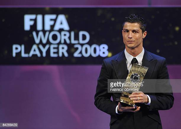 Portuguese football player Cristiano Ronaldo poses with FIFA world footballer of the year 2008 award during a ceremony on January 12 2009 in Zurich...
