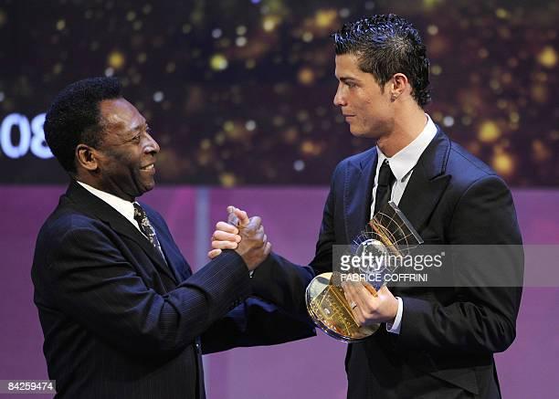 Portuguese football player Cristiano Ronaldo receives congratulations from Brazilian football legend Pele after recieving the FIFA world footballer...