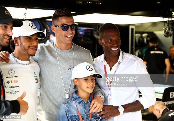 Portuguese football superstar Cristiano Ronaldo meets Lewis Hamilton of Great Britain and Mercedes GP during practice for the F1 Grand Prix of Monaco...