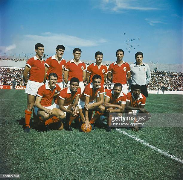 Portuguese football team Sport Lisboa e Benfica posed together on a football pitch in Lisbon Portugal on 20th September 1967 Back row from left to...