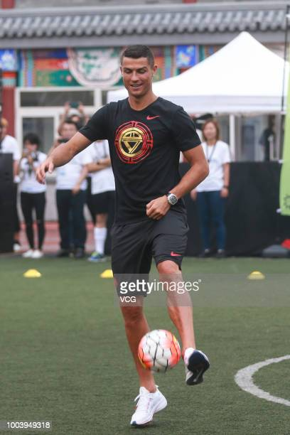Portuguese footballer Cristiano Ronaldo plays football as he visits Beijing Haidian Minzu Primary School during his China tour on July 19 2018 in...