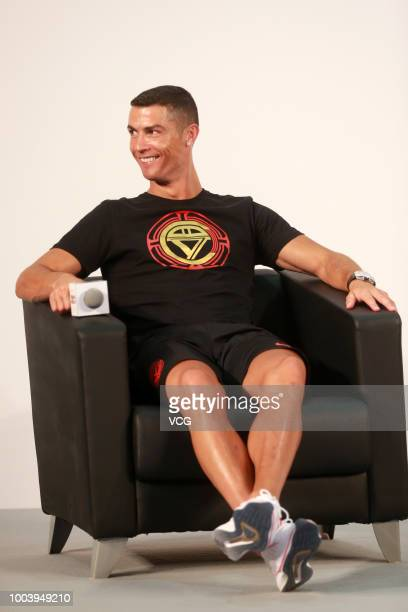 Portuguese footballer Cristiano Ronaldo poses at Beijing Haidian Minzu Primary School during his China tour on July 19 2018 in Beijing China