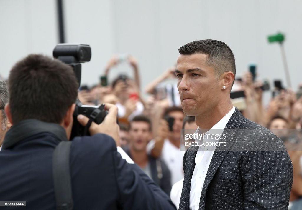 Portuguese footballer cristiano ronaldo walks out the juventus portuguese footballer cristiano ronaldo walks out the juventus medical center at the alliance stadium in turin m4hsunfo