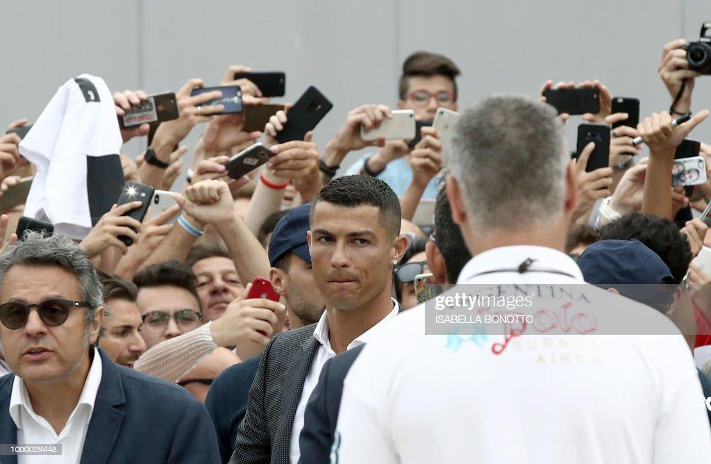 Portuguese footballer cristiano ronaldo c walks out the juventus portuguese footballer cristiano ronaldo c walks out the juventus medical center at the alliance m4hsunfo