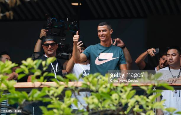 Portuguese footballer Cristiano Ronaldo waves to fans during his China tour on July 19 2018 in Beijing China