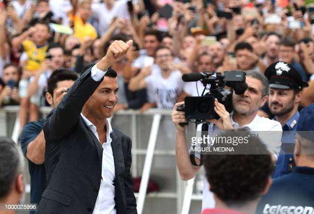Portuguese footballer Cristiano Ronaldo waves to supporters as he arrives on July 16 2018 at the Juventus medical centre at the Alliance stadium in...
