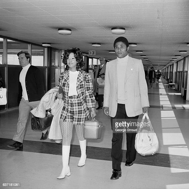 Portuguese footballer Eusebio of Benfica FC and his wife Flora arrive at London Airport UK 3rd May 1971
