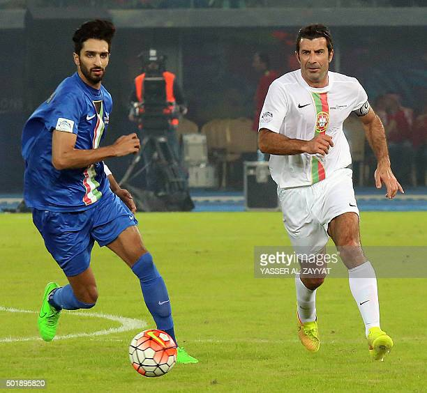 Portuguese footballer Luis Figo fights for the ball with Kuwait's Fahad alAnsari during a friendly ceremonial match between Kuwait allstars team and...