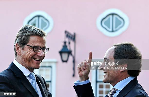 Portuguese Foreign Minister Paulo Portas welcomes his German counterpart Guido Westerwelle before their meeting at Necessidades Palace in Lisbon on...