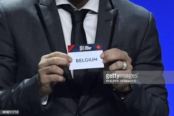 Portuguese former football player Deco shows the name of Belgium during the UEFA Nations League draw at the headquarters of the European football...