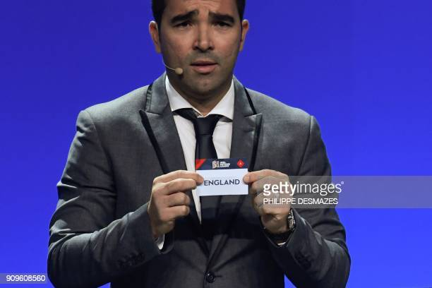 Portuguese former football player Deco shows the name of England during the UEFA Nations League draw at the headquarters of the European football...
