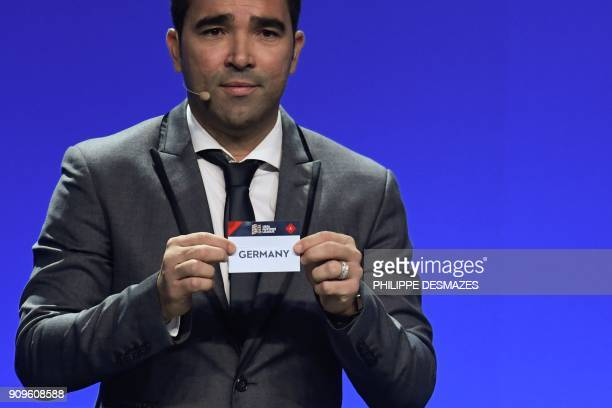 Portuguese former football player Deco shows the name of Germany during the UEFA Nations League draw at the headquarters of the European football...