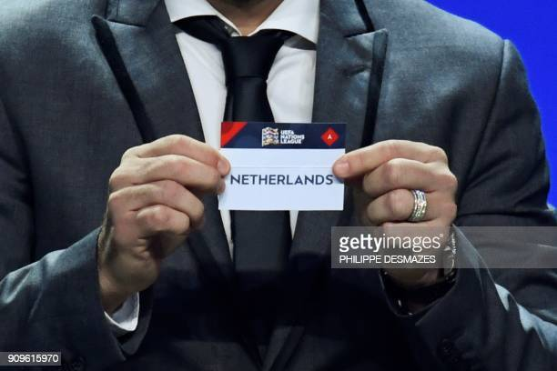 Portuguese former football player Deco shows the name of Netherlands during the UEFA Nations League draw at the headquarters of the European football...