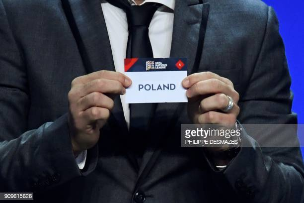 Portuguese former football player Deco shows the name of Poland during the UEFA Nations League draw at the headquarters of the European football...