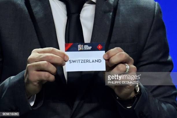 Portuguese former football player Deco shows the name of Switzerland during the UEFA Nations League draw at the headquarters of the European football...