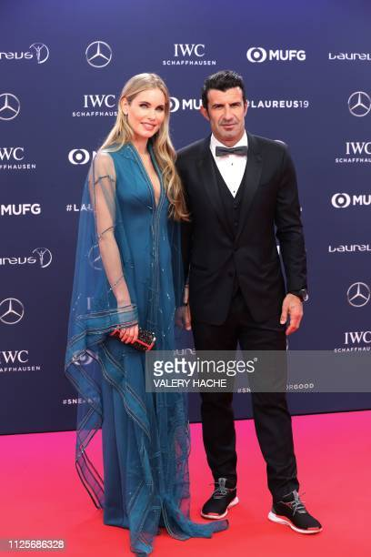 Portuguese former football player Luis Figo poses with his wife Helen Svedin on the red carpet before the 2019 Laureus World Sports Awards ceremony...