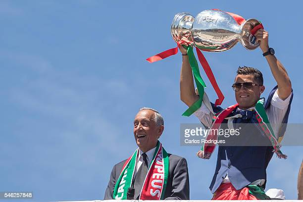 Portuguese forward Cristiano Ronaldo and Portuguese President Marcelo Rebelo de Sousa showing the European cup to the supporters during the meeting...