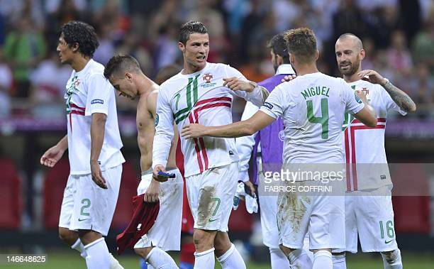 Portuguese forward Cristiano Ronaldo and team mates celebrate after winning the Euro 2012 football championships quarterfinal match between the Czech...