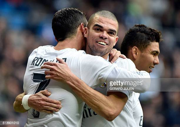 Portuguese forward Cristiano Ronaldo celebrates a goal with Real Madrid's Portuguese defender Pepe during the Spanish league football match Real...