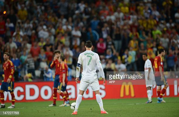 Portuguese forward Cristiano Ronaldo concentrates before a free kick during the Euro 2012 football championships semifinal match Portugal vs Spain on...