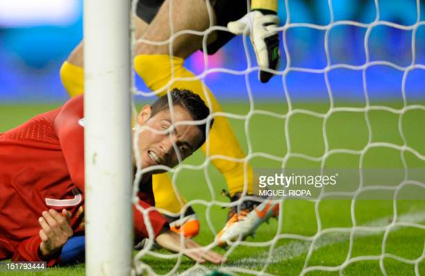 Portuguese forward Cristiano Ronaldo falls on the pitch close to Azerbaijan's goalkeeper during the FIFA World Cup 2014 qualifying football match...