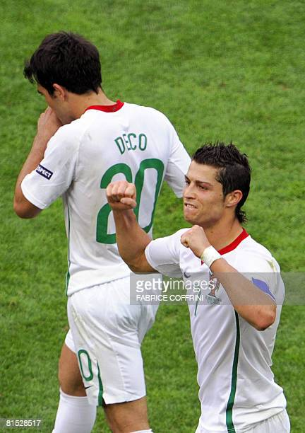 Portuguese forward Cristiano Ronaldo gestures in celebration as Portuguese midfielder Deco walks by after their Euro 2008 Championships Group A...