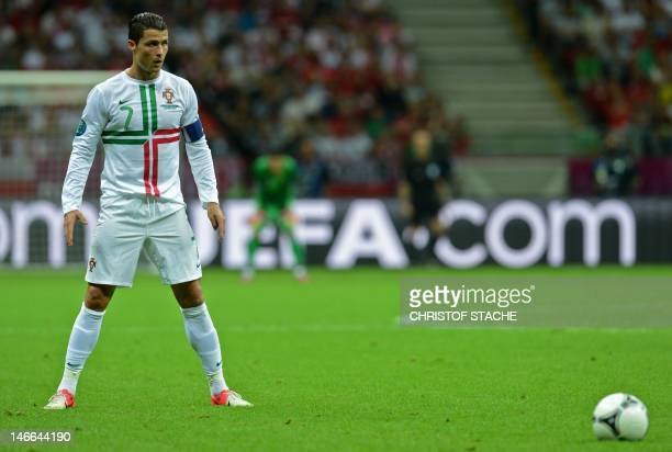 Portuguese forward Cristiano Ronaldo gets ready to shoot a free kick during the Euro 2012 football championships quarterfinal match the Czech...
