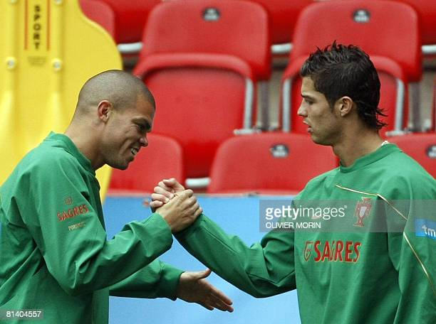 Portuguese forward Cristiano Ronaldo jokes with defender Pepe during a training session in Neuchatel on June 04 ahead of the Euro 2008 Football...