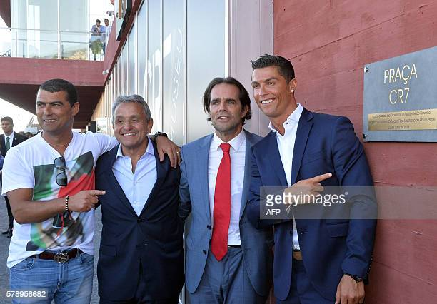 Portuguese forward Cristiano Ronaldo poses with his brother Hugo Aveiro , owner and chairman of Pestana Hotel Group, Dionisio Pestana and the...
