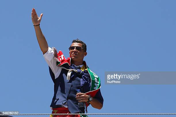 Portuguese forward Cristiano Ronaldo speaks to the Portuguese supportes during the Portugal Euro 2016 Victory Parade at Lisbon on July 11 2016 in...