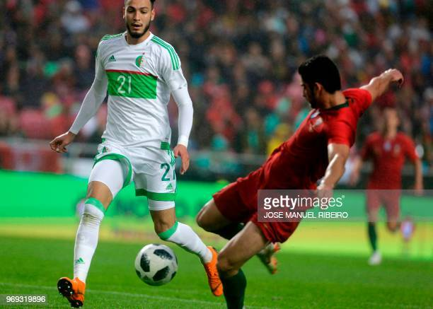 Portuguese forward Goncalo Guedes kicks for goal in front of Algerian defender Rami Bensebaini during the friendly football match between Portugal...
