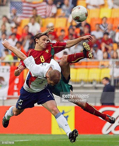 Portuguese forward Joao Pinto and US midfielder John O'Brien clash in their Group D match at the 2002 FIFA World Cup Korea/Japan in Suwon, 05 June...