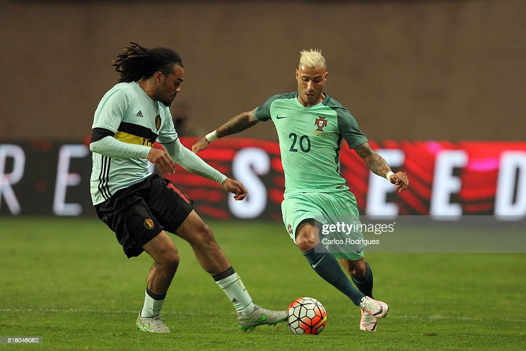 Portuguese forward Ricardo Quaresma (R) tries to escape Belgium defender Denayer during the match between Portugal and Belgium Friendly International at Estadio Municipal de Leiria on March 29, 2016 in Lisbon, Portugal.