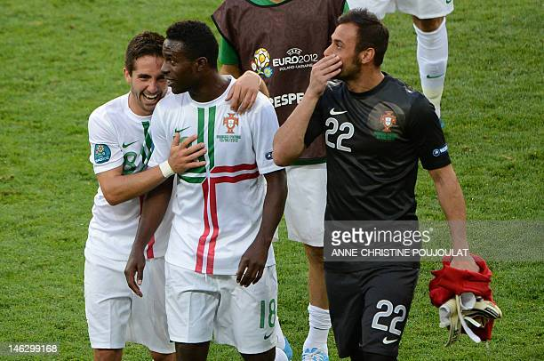Portuguese forward Silvestre Varela celebrates with Portuguese goalkeeper Beto and Portuguese midfielder Joao Moutinho at the end of the Euro 2012...