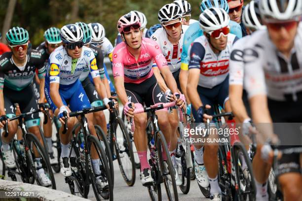Portuguese Joao Almeida of Deceuninck - Quick-Step wearing the pink jersey of leader in the overall ranking pictured in action during stage 15 of the...