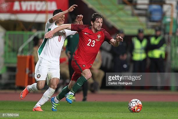 Portuguese midfielder Adrien Silva tries to escape Bulgaria forward Marcelinho during the match between Portugal and Bulgaria Friendly International...