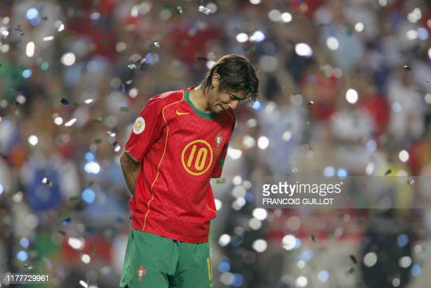 Portuguese midfielder Rui Costa cries 04 July 2004 at the Luz stadium in Lisbon, after the Euro 2004 final match between Portugal and Greece at the...
